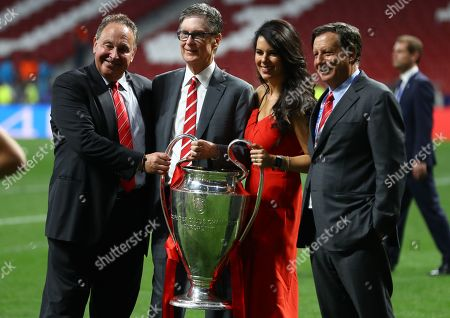 Liverpool owner John W Henry, wife Linda Pizutti and chairman Tom Werner with the trophy
