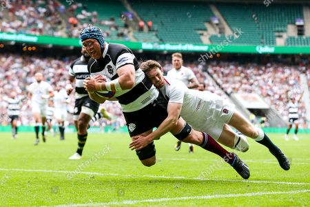 James Horwill of Barbarians scores a try as Simon Hammersley of England XV challenges