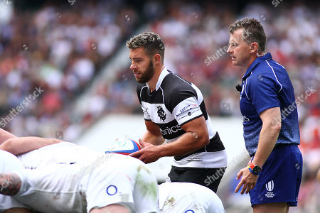 Rhys Webb of Barbarians prepares to feed into a scrum