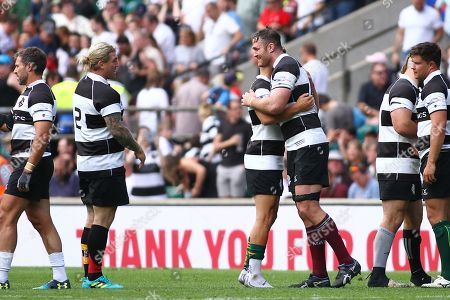 Stock Picture of James Horwill of Barbarians is congratulated by team mates, as he retires from the game
