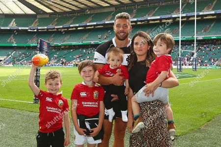 Stock Photo of Rhys Webb of Barbarians spends a little time with his family at the end of the game