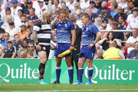 Richard Hibbard of Barbarians chats with officials Andrew Brace and Nigel Owens