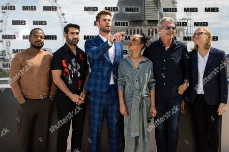 F. Gary Gray, Kumail Nanjiani, Chris Hemsworth, Tessa Thompson, Walter F.Parkes, Laurie MacDonald. F. Gary Gray, Kumail Nanjiani, Chris Hemsworth, Tessa Thompson, Walter F.Parkes and Laurie MacDonald pose for photographers during a photo call for the film 'Men in Black: International' in London