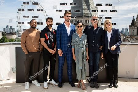 Stock Picture of F. Gary Gray, Kumail Nanjiani, Chris Hemsworth, Tessa Thompson, Walter F.Parkes, Laurie MacDonald. F. Gary Gray, Kumail Nanjiani, Chris Hemsworth, Tessa Thompson, Walter F.Parkes and Laurie MacDonald pose for photographers during a photo call for the film 'Men in Black: International' in London