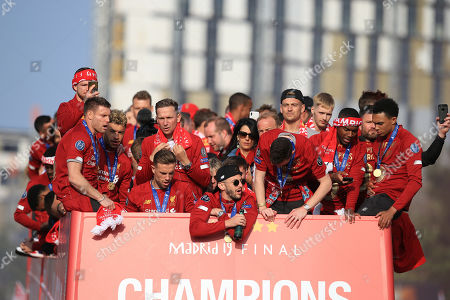 James Milner, Alex Oxlade-Chamberlain, Jordan Henderson, Adam Lallana, Alberto Moreno, Daniel Sturridge and Trent Alexander-Arnold of Liverpool during an open top bus parade through Liverpool to celebrate victory in the UEFA Champions League