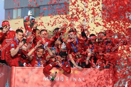 James Milner, Pepjin Ljinders, Jordan Henderson, Adam Lallana, Ben Woodburn, Daniel Sturridge, Andy Robertson and Trent Alexander-Arnold of Liverpool during an open top bus parade through Liverpool to celebrate victory in the UEFA Champions League