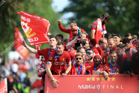James Milner, Andy Robertson, Alex Oxlade-Chamberlain, Daniel Sturridge of Liverpool on an open top bus parade through Liverpool to celebrate victory in the UEFA Champions League