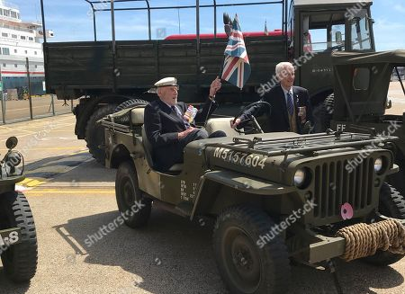 95-year old D-Day Veteran John Roberts, left, sits in a jeep as he arrives to the cruise terminal with fellow vets ahead of their departure from the port of Dover, England, for a trip to France arranged by the Royal British Legion for D-Day veterans to mark the 75th anniversary of D-Day. There are many events over the coming days to mark the 75th anniversary of the mass landings by the Allies against Nazi German forces on Tuesday June 6, 1944, in Normandy, France, that became known as D-Day