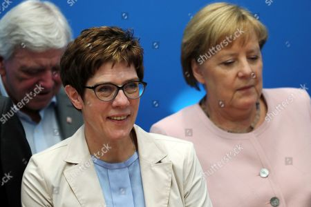 Christian Democratic Union (CDU) party chairwoman Annegret Kramp-Karrenbauer (C), German Chancellor Angela Merkel (R) and Premier of Hesse and deputy leader Volker Bouffier (L) take part in the meeting of the party's federal board in the headquarters in Berlin, Germany, 02 June 2019. The CDU will discuss the actions to be taken after the results in the last European elections.