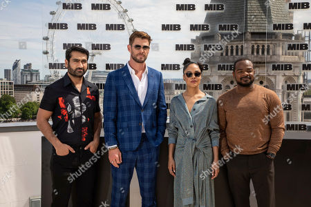 Kumail Nanjiani, Chris Hemsworth, Tessa Thompson, F. Gary Gray. Actors Kumail Nanjiani, from left Chris Hemsworth, Tessa Thompson and director F. Gary Gray pose for photographers during a photo call for the film 'Men in Black: International' in London