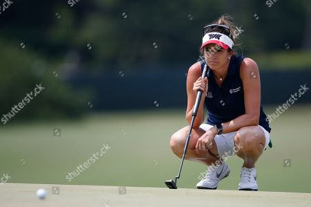 Gerina Piller lines up a putt on the 14th green during the final round of the U.S. Women's Open golf tournament, in Charleston, S.C