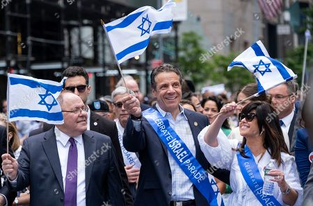 Stock Photo of New York Gov. Andrew Cuomo, center, joins other participants as they take part in the Celebrate Israel Parade, in New York. Left is Consul General of Israel in New York Dani Dayan