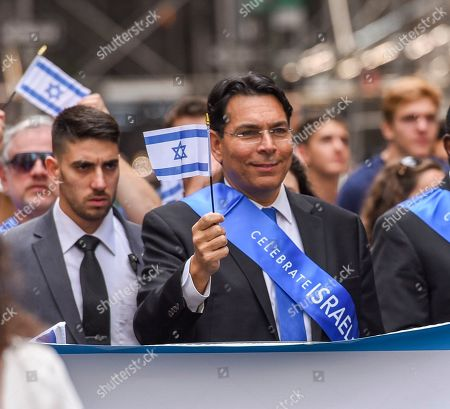 Danny Danon (C), Israel's ambassador to the United Nations, marches during the Celebrate Israel Parade on Fifth Avenue in New York, New York, USA, 02 June 2019.  The theme of this year's parade, 'Only In Israel' celebrates the diverse State of Israel and features musicians, dancers, floats and marching bands.