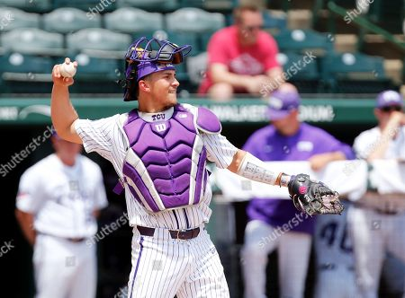 TCU catcher Alex Isola #34 returns a ball to the mound. TCU defeated Central Connecticut 9-5 in Fayetteville, AR, Richey Miller/CSM