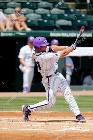 Alex Isola #34 TCU batter follows through on his swing at the plate. TCU defeated Central Connecticut 9-5 in Fayetteville, AR, Richey Miller/CSM