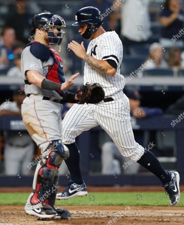 Chrisitan Vazquez, Gary Sanchez. New York Yankees' Gary Sanchez, right, runs past Boston Red Sox catcher Christian Vazquez as he scores on Gio Urshela's sacrifice fly during the fourth inning of a baseball game, in New York