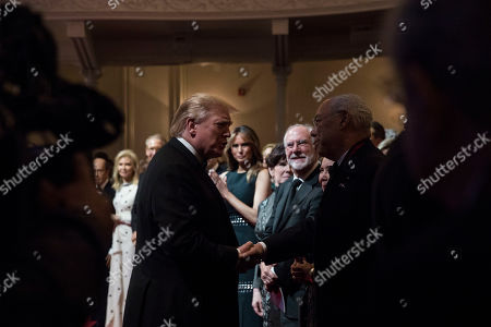 US President Donald Trump (C-L) shakes hands with Former United States National Security Advisor Colin Powell (C-R) before delivering remarks at the Ford's Theatre Society Annual Gala at Ford?s Theatre in Washington, DC, USA, 02 June 2019.