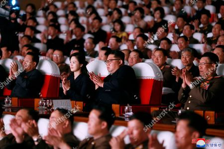 "In this June 2, 2019, photo provided, by the North Korean government, North Korean leader Kim Jong Un, center right, and his wife Ri Sol Ju, center left, clap hands in a musical performance by the wives of Korean People's Army officers in North Korea. A senior North Korean official who had been reported as purged over the failed nuclear summit with Washington was shown in state media enjoying a concert alongside leader Kim Jong Un. Independent journalists were not given access to cover the event depicted in this image distributed by the North Korean government. The content of this image is as provided and cannot be independently verified. Korean language watermark on image as provided by source reads: ""KCNA"" which is the abbreviation for Korean Central News Agency"