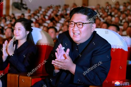 "In this June 2, 2019, photo provided, by the North Korean government, North Korean leader Kim Jong Un, right, and his wife Ri Sol Ju, left, clap hands in a musical performance by the wives of Korean People's Army officers in North Korea. A senior North Korean official who had been reported as purged over the failed nuclear summit with Washington was shown in state media enjoying a concert alongside leader Kim. Independent journalists were not given access to cover the event depicted in this image distributed by the North Korean government. The content of this image is as provided and cannot be independently verified. Korean language watermark on image as provided by source reads: ""KCNA"" which is the abbreviation for Korean Central News Agency"