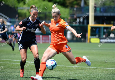 KEALIA OHAI (7) takes a shot against the Reign's THERESA NIELSEN (8) as the Houston Dash take on the Reign FC in a NWSL match at Cheney Stadium in Tacoma, WA. © Jeff Halstead / CSM