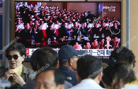 Kim Jong Un, Kim Yong Chol. People watch a TV screen showing an image of North Korean leader Kim Jong Un, third from left, and senior North Korean official Kim Yong Chol, right, in a musical performance by the wives of Korean People's Army officers in North Korea during a news program at the Seoul Railway Station in Seoul, South Korea, . A senior North Korean official who had been reported as purged over the failed nuclear summit with Washington was shown in state media on Monday enjoying a concert alongside leader Kim Jong Un