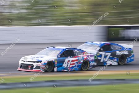 Monster Energy NASCAR Cup Series driver Ryan Preece (47) rounds turn three pursued by driver Ryan Newman (17) during the Pocono 400 at Pocono Raceway in Long Pond, PA Daniel Lea/CSM