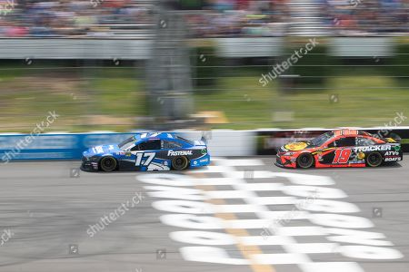 Monster Energy NASCAR Cup Series driver Ricky Stenhouse Jr. (17) speeds down the straightaway chased by Series driver Martin Truex Jr. (19) during the Pocono 400 at Pocono Raceway in Long Pond, PA Daniel Lea/CSM