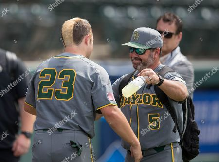 Stock Photo of Los Angeles, CA..Baylor catcher (23) Shea Langeliers and coach (5) Steve Rodriguez have some after games smiles and tears, when the Bears where eliminated, in a NCAA regional elimination game between the Baylor Bears and the UCLA Bruins at Jackie Robinson Stadium in Los Angeles, California. UCLA beat Baylor 11-6. .(Mandatory Credit: Juan Lainez / MarinMedia.org / Cal Sport Media)