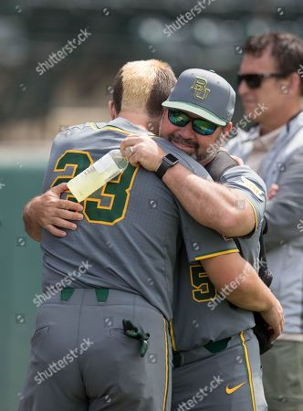 Los Angeles, CA..Baylor catcher (23) Shea Langeliers and coach (5) Steve Rodriguez have some after games smiles and tears, when the Bears where eliminated, in a NCAA regional elimination game between the Baylor Bears and the UCLA Bruins at Jackie Robinson Stadium in Los Angeles, California. UCLA beat Baylor 11-6. .(Mandatory Credit: Juan Lainez / MarinMedia.org / Cal Sport Media)