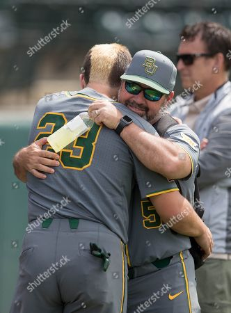 Stock Picture of Los Angeles, CA..Baylor catcher (23) Shea Langeliers and coach (5) Steve Rodriguez have some after games smiles and tears, when the Bears where eliminated, in a NCAA regional elimination game between the Baylor Bears and the UCLA Bruins at Jackie Robinson Stadium in Los Angeles, California. UCLA beat Baylor 11-6. .(Mandatory Credit: Juan Lainez / MarinMedia.org / Cal Sport Media)
