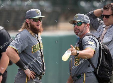 Stock Image of Los Angeles, CA..Baylor third baseman (47) Davis Wendzel and coach (5) Steve Rodriguez have some after games smiles and tears, when the Bears where eliminated, in a NCAA regional elimination game between the Baylor Bears and the UCLA Bruins at Jackie Robinson Stadium in Los Angeles, California. UCLA beat Baylor 11-6. .(Mandatory Credit: Juan Lainez / MarinMedia.org / Cal Sport Media)