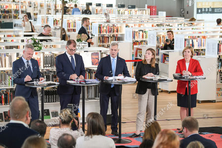 (L-R) Green Party leader Pekka Haavisto, Centre Party leader Juha Sipila, Democratic Party leader Antti Rinne, Left Alliance leader Li Andersson and Swedish People's Party of Finland leader Anna-Maja Henriksson attend a government press conference announcing the new Finnish Government Programme at Helsinki Central Library Oodi in Helsinki, Finland, 03 June 2019.