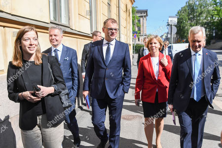 (L-R) Left Alliance leader Li Andersson, Green Party leader Pekka Haavisto, Centre Party leader Juha Sipila, Swedish People's Party of Finland leader Anna-Maja Henriksson and  Democratic Party leader Antti Rinne on their way to a press conference announcing the new Finnish Government Programme at Helsinki Central Library Oodi in Helsinki, Finland, 03 June 2019.