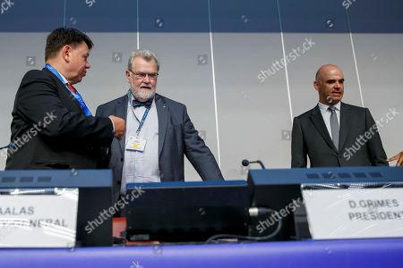 (L-R) WMO Secretary-General, Finland's Petteri Taalas, President of WMO David Grimes and Swiss Interior Minister Alain Berset arrive on the podium, prior the opening of the Eighteenth World Meteorological Congress, in Geneva, Switzerland, 03 June 2019.