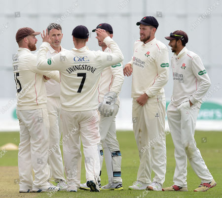 Lancashire gather to congratulate Graham Onions on the wicket of Cosgrove
