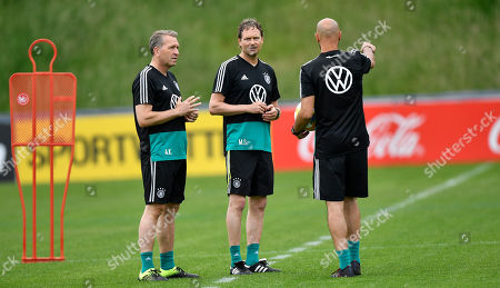 Stock Image of German interims head coach Marcus Sorg, center, stands with his assistant coaches Andreas Koepke, left, and Antonio Di Salvo, right, during a training of Germany's national soccer team in Venlo, Netherlands, . Germany will play the next EURO 2020 qualifier matches in Belarus and against Estonia without head coach Joachim Loew who suffers a sport injury
