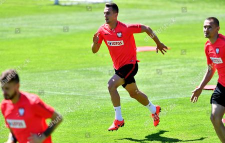 Polish national soccer team players Arkadiusz Milik (C) warms up during his team's training session in Warsaw, Poland, 03 June 2019. Poland will face North Macedonia for a  UEFA EURO 2020 qualifier match on 07 June in Skopje.