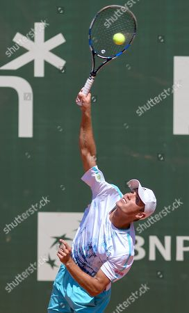 Stock Photo of Kacper Zuk of Poland serves the ball to Daniel Masur of Germany during their first round match at the Challenger ATP Poznan Open tennis tournament in Poznan, Poland, 03 June 2019.