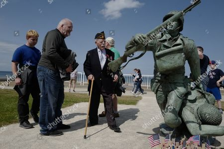 Normandy veteran US, Glen Campbell, of the third armored division, looks at the National Guard Memorial, a statue representing US soldiers who landed at Omaha Beach, in Vierville-sur-Mer, in Normandy, France, 03 June 2019, ahead of the 75th D-Day anniversary, in Normandy on 06 June 2019. World leaders are to attend memorial events in Normandy, France on 06 June 2019 to mark the 75th anniversary of the D-Day landings, which marked the beginning of the end of World War II in Europe.