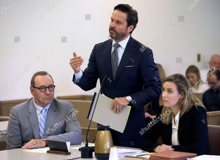 Actor Kevin Spacey, left, sits beside attorney Alan Jackson addressing the court in a pretrial hearing, at district court in Nantucket, Mass. The Oscar-winning actor is accused of groping the teenage son of a former Boston TV anchor in 2016 in the crowded bar at the Club Car in Nantucket