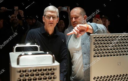 Apple CEO Tim Cook, left, and chief design officer Jonathan Ive look at the Mac Pro in the display room at the Apple Worldwide Developers Conference in San Jose, Calif