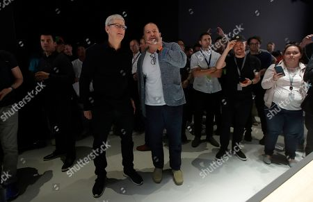 Stock Picture of Apple CEO Tim Cook, left, and chief design officer Jonathan Ive talk in the display room at the Apple Worldwide Developers Conference in San Jose, Calif