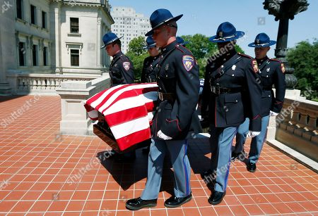Members of a Mississippi Highway Patrol honor guard carry the casket of the late Republican Sen. Thad Cochran, into the state Capitol in Jackson, Miss., for a funeral service, . Cochran was 81 when he died Thursday in a veterans' nursing home in Oxford, Miss
