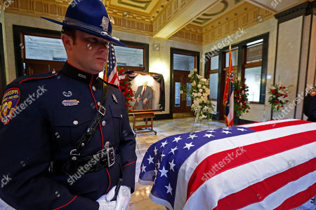 Mississippi Highway Patrol honor guard member Robert Faulkner stands watch over the casket of the late Republican Sen. Thad Cochran, during the first of two funeral services, in the Mississippi State Capitol rotunda in Jackson, Miss., . Cochran was 81 when he died Thursday in a veterans' nursing home in Oxford, Mississippi