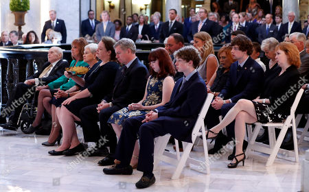 Family members of the former Republican senator Thad Cochran, sit in attendance at his funeral service in the Mississippi State Capitol rotunda in Jackson, Miss., . Cochran was 81 when he died Thursday in a veterans' nursing home in Oxford, Miss
