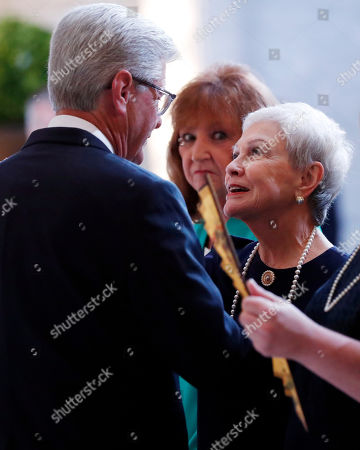 Kay Webber Cochran, right, widow of the late former U.S. Senator Thad Cochran, speaks with Mississippi Gov. Phil Bryant, left, during the first of two funeral services for the late Republican senator Thad Cochran, in the Mississippi State Capitol rotunda in Jackson, Miss., . Cochran was 81 when he died Thursday in a veterans' nursing home in Oxford, Mississippi. He was the 10th longest serving senator