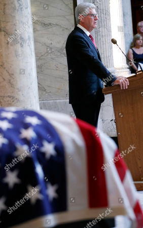 Mississippi Gov. Phil Bryant delivers remarks at the funeral of the late Republican senator Thad Cochran, in the Mississippi State Capitol rotunda in Jackson, Miss., . Cochran was 81 when he died Thursday in a veterans' nursing home in Oxford, Miss. He was the 10th longest serving senator