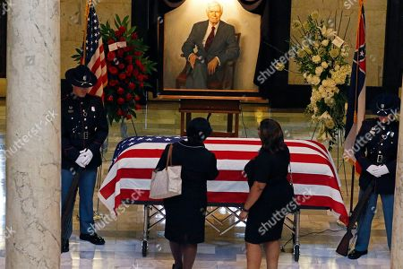 Mourners pay their respects following a funeral service for the late Republican Sen. Thad Cochran, in the Mississippi State Capitol rotunda in Jackson, Miss., . Cochran was 81 when he died Thursday in a veterans' nursing home in Oxford, Mississippi. He was the 10th longest serving senator