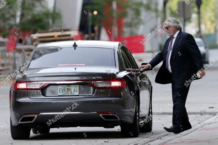 Carnival Corp. Chairman Micky Arison leaves federal court, in Miami. Carnival Corp. reached a settlement with federal prosecutors in which the world's largest cruise line agreed to pay a $20 million penalty for its ships continuing to pollute the ocean despite promising years ago to stop