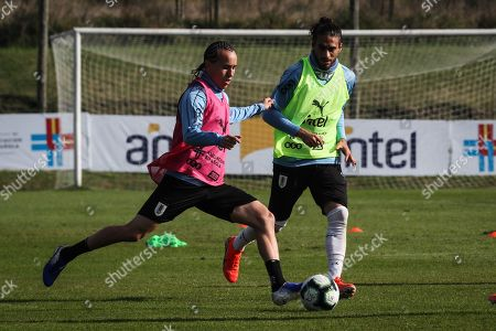 Uruguay's national soccer team Diego Laxalt(L) and Martin Caceres (R) participate in a training session to prepare for the Copa America 2019, in Montevideo, Uruguay, 03 June 2019.